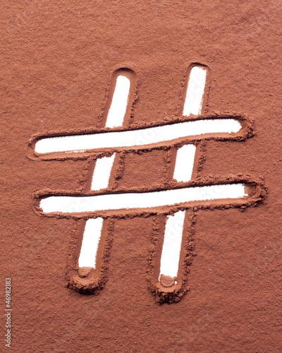Hash mark drawn on cocoa powder