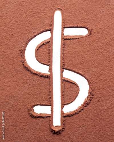 Dollar drawn on cocoa powder