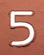 Number 5 made of cocoa powder