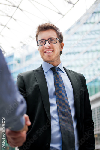 Outdoor businessmen handshake