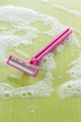 Pink disposable razor with foam