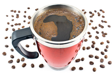 Red thermos with coffee drink and beans