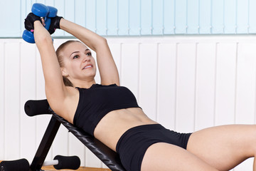closeup woman training witn dumbbells