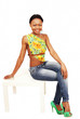 Cute smiling ethnic female in seated full length pose