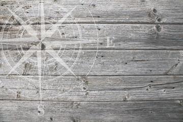 weiße Windrose auf Holz