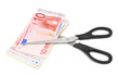 Scissors and banknote euro. On a white background.