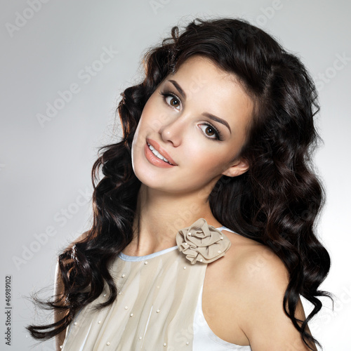 Beautiful smiling  woman with long brown hair