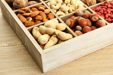 assortment of tasty nuts in  wooden box