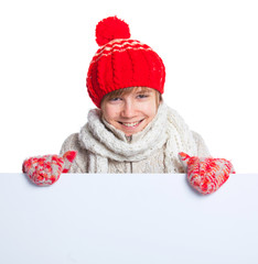 Teenager in winter style looking at a blank board