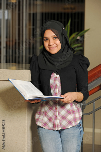 Young Eastern Student holding a book