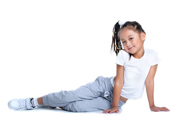 Asian little girl in sportswear sitting on floor