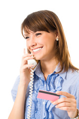 Young businesswoman with plastic card, on phone