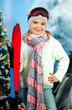 portrait of a beautiful girl in a cap with skis on background sn