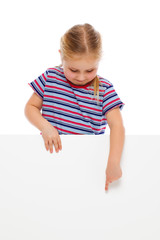 Little girl pointing at whiteboard.