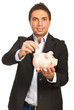 Business man put coin to piggy