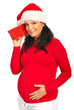 Pregnant woman listening to Xmas gift