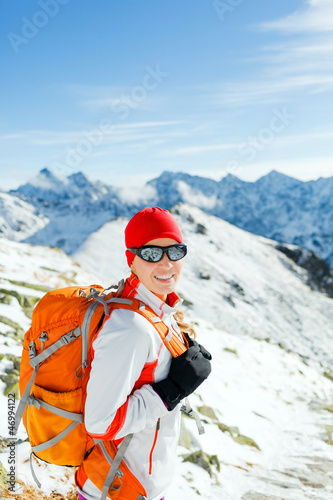 Hiking and walking woman in winter mountains