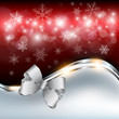 Abstract christmas background with snowflakes and a bow