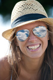 Young beautiful woman portrait with straw hat and sunglasses.