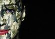Camouflage painted on woman a face