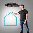 Man holding umbrella over symbolic home