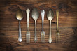 Old forks and spoons on wooden background