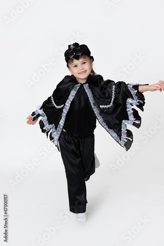 Girl wearing fancy dress of a black crow