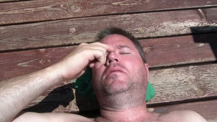 Man Putting Sunscreen on Face