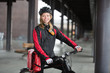 Female Cyclist With Courier Bag