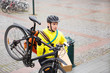 Courier Delivery Man With Package And Bicycle Walking Up Steps
