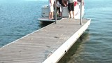 Boat Picking Up People on Dock