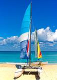 Two beautiful sailing boats on a cuban beach