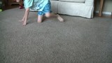 Boy Chasing Puppy Around in House