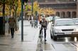 Male Cyclist Using Walkie-Talkie On Street