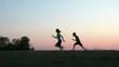 Boy Chasing Girl at Sunset