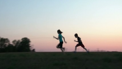 Boy Chasing Girl at Sunset