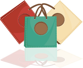 Collection of 3 different coloured bags with brown handles