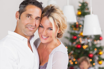Couple embracing at christmas
