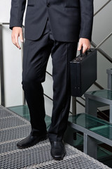 Businessman With Briefcase Standing By Steps