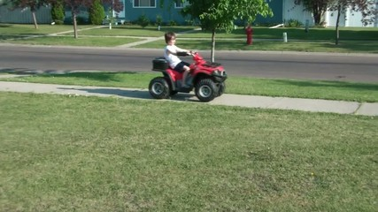 Boy On 4 Wheeler in Front Yard