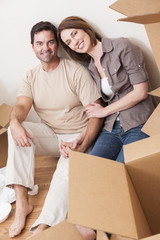 Happy Couple Unpacking or Packing Boxes Moving House