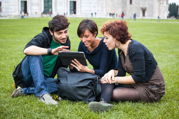 Group of Friends with Tablet PC Outside