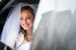 Portrait of a beautiful young bride waiting in the car