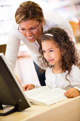 Girl learning to use technology