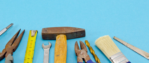 various construction work tools on blue