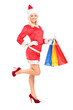Female in christmas costume holding shopping bags
