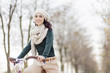 Young woman on the bicycle