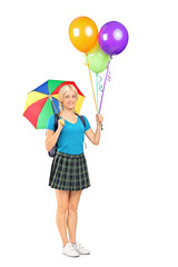 Female student holding an umbrella and balloons