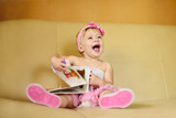 baby girl with book