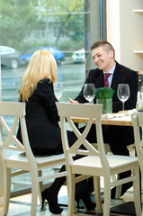 Young businesspeople in a restaurant having a  meeting